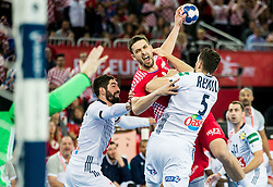 Marko Kopljar of Croatia between Nikola Karabatic of France and Nadim Remili of France during handball match between National teams of Croatia and France on Day 7 in Main Round of Men's EHF EURO 2018, on January 24, 2018 in Arena Zagreb, Zagreb, Croatia.  Photo by Vid Ponikvar / Sportida