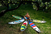 Although born in Brazil, Kailani Jabour grew up on the North Shore of Oahu, HI.  Two years ago he set aside his path to become a pro surfer to attend Brooks Institute in Ventura Calif.  Jabour still makes surfing a top priority, earning a sponsorship from Katin.  This quiver portrait was made outside his home in Ventura Calif., on Tuesday, Jan. 30, 2012.  (Photo by Aaron Schmidt © 2012)