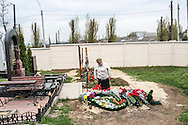 KHARKIV, UKRAINE - APRIL 22: A woman visits the grave of Vladislav Zubenko, who died after being shot during the Euromaidan protests in Kiev in February, on what would have been his 23rd birthday on April 22, 2014 in Kharkiv, Ukraine. Following turbulence with the central government, pro-Russian activists have been occupying government buildings and demanding greater autonomy in many Eastern Ukrainian cities in recent weeks. (Photo by Brendan Hoffman/Getty Images) *** Local Caption ***