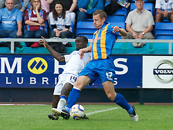 SHREWSBURY, ENGLAND - Saturday, August 25, 2012: Tranmere Rovers' Adam McGurk in action against Shrewsbury Town's Paul Parry during the Football League One match at Greenhous Meadow. (Pic by Dave Richards/Propaganda)