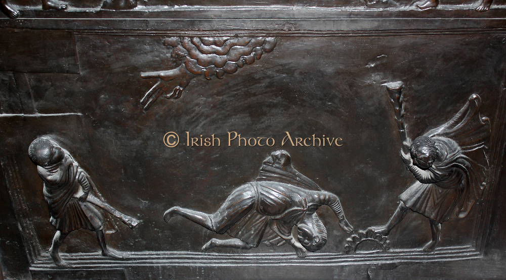 Detail from Bronze doors with scenes from the Old and New Testament in relief. Made at the order of St. Bernward, and set up by him in 1015 at St. Michael's Church, Hildesheim. They were since taken to the cathedral by his successor. This panel shows the Murder of Abel.