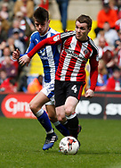 John Fleck of Sheffield Utd in action with Joe Rowley of Chesterfield during the English League One match at  Bramall Lane Stadium, Sheffield. Picture date: April 30th 2017. Pic credit should read: Simon Bellis/Sportimage