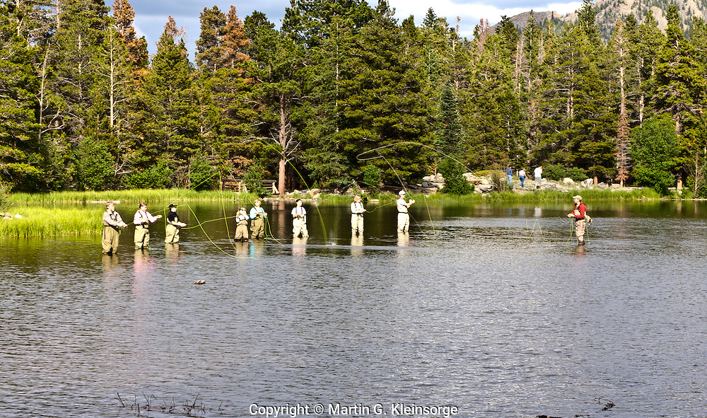 Private vendors offer fly fishing lessons at Sprague Lake.  Rocky Mountain National Park,  Colorado.