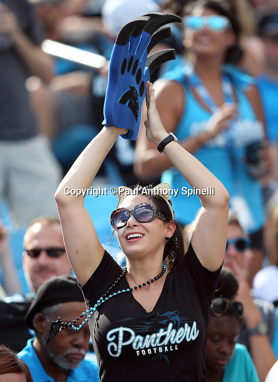 A Carolina Panthers fan with a foam claw cheers during the Carolina Panthers 2015 NFL week 2 regular season football game against the Houston Texans on Sunday, Sept. 20, 2015 in Charlotte, N.C. The Panthers won the game 24-17. (©Paul Anthony Spinelli)