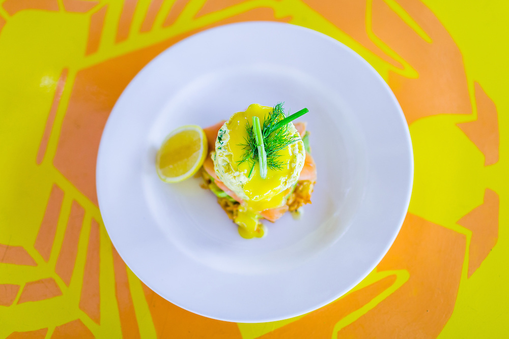 Dill & Chive soft scrambled eggs with smoked salmon, hollandaise, avocado, lemon on a crispy hash brown.