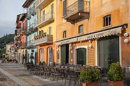Colorful building exteriors along the waterfront promenade, Cannobio, Italy, along Lake Maggiore.