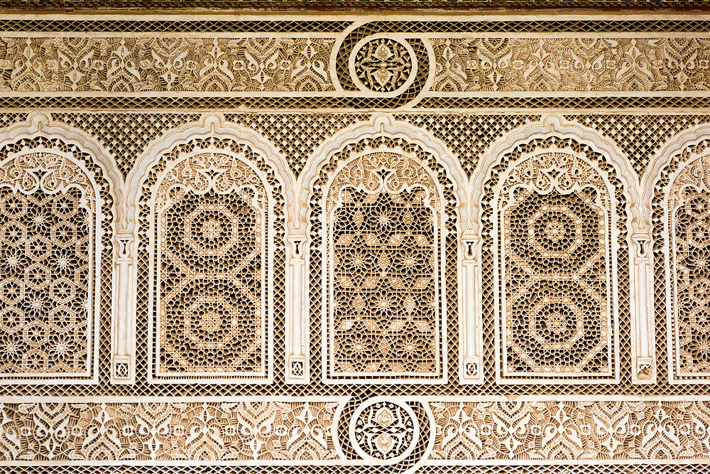 Intricate stone, wood work carvings, textures and paintings, Bahia Palace, Marrakesh, Morocco, 2016–04-21. <br />