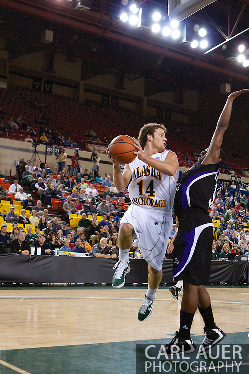 November 25th, 2010:  Anchorage, Alaska - University of Alaska-Anchorage guard Steve White (14) looks to pass in the Seawolves 54-86 loss to Weber State in the first round of the Great Alaska Shootout.