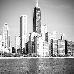 Chicago Hancock Building black and white picture.  Photo includes John Hancock Center Building and Northern Chicago skyline along the Lake Michigan shoreline.