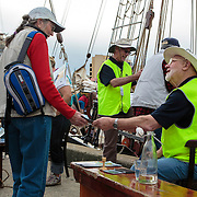 Eddie Thorpe (Seated) and Michael Geard (standing) check Passports for Oosterschelde, Tall Ships Festival 2013, Hobart, Tasmania, Australia, Oceania