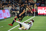 LAFC forward Adrien Perez (26) is defended by Minnesota United defender Wilfred Moimbe during an MLS soccer match. Minnesota United defeated theLAFC 2-0 on Sunday Sept. 1 2019, in Los Angeles. (Ed Ruvalcaba/Image of Sport)