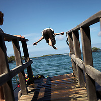 Mike Ehrlich, a University of North Carolina student, took a diving plunge from a dock while on an afternoon swim in Puerto Villamil on Isabela island, Galapagos on 6/22/09. Ehrlich was on the island for two weeks working on a documentary project for a class.