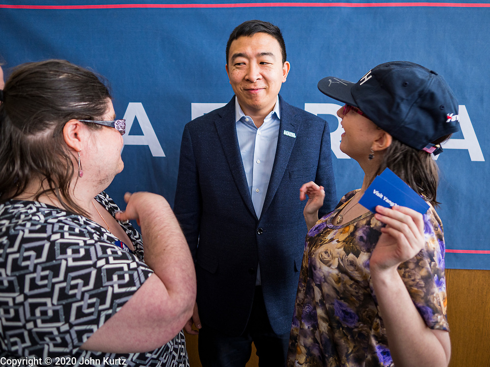 22 JANUARY 2020 - CHARLES CITY, IOWA: ANDREW YANG talks to women who approached him after speaking at a campaign event in the public library in Charles City, IA. Yang, an entrepreneur, is running for the Democratic nomination for the US Presidency in 2020. He is in northern Iowa as a part of his 17 day bus tour across the state. Iowa hosts the the first election event of the presidential election cycle. The Iowa Caucuses will be on Feb. 3, 2020.         PHOTO BY JACK KURTZ