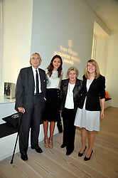Left to right, GORDON REBUCK, GRACE GOULD, MAVIS REBUCK and GEORGIA GOULD at the presentation of the Veuve Clicquot Business Woman Award 2009 hosted by Graham Boyes MD Moet Hennessy UK and presented by Sir Trevor Macdonald at The Saatchi Gallery, Duke of York's Square, Kings Road, London SW1 on 28th April 2009.