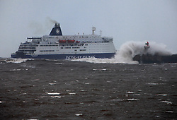 Licensed to London News Pictures. 23/03/2013. Tynemouth, North Tyneside, UK. DFDS Ferry hits very rough seas as she leaves the River Tyne on her overnight crossing of the North Sea from Newcastle to Amsterdam. Photo credit: Adrian Don/LNP
