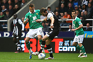 Picture by Paul Chesterton/Focus Images Ltd.  07904 640267.18/03/12.Anthony Pilkington of Norwich and Mike Williamson of Newcastle in action during the Barclays Premier League match at St James' Park Stadium, Newcastle.