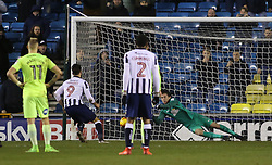 Lee Gregory of Millwall scores the only goal of the game from the penalty spot past Luke McGee of Peterborough United - Mandatory by-line: Joe Dent/JMP - 28/02/2017 - FOOTBALL - The Den - London, England - Millwall v Peterborough United - Sky Bet League One