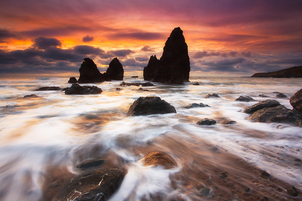 rodeo beach near sausalito in the marin headlands. giant sea stacks with a gently pink sunrise after a pacific coast storm