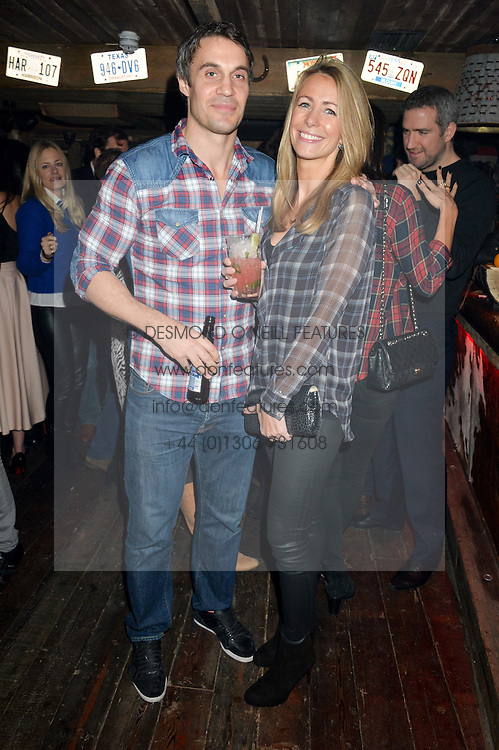 ADAM BIDWELL and ANNEKE GILKES at a party to celebrate the opening of Beaver Lodge, a new bar & club from the Inception Group at 266 Fulham Road, London SW10 on 4th December 2014.