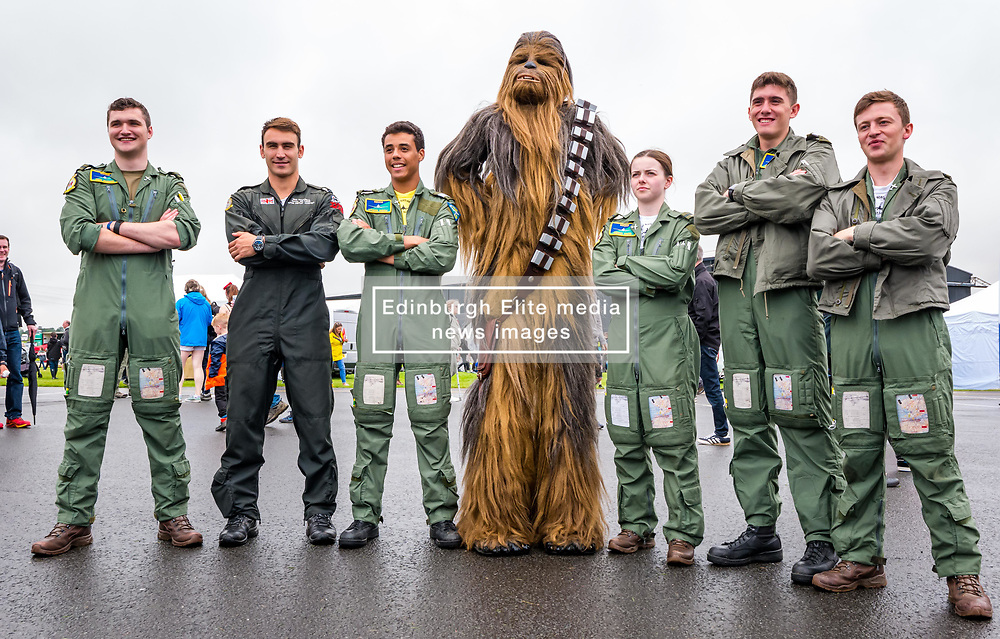 Pictured: Scotland's National Airshow, East Fortune, East Lothian, Scotland, United Kingdom, 27 July 2019 . A packed programme of aircraft old and new planned to take to the skies for the aerial display was marred by poor weather at airfields around the country which meant that many of the promised flights were unable to perform. Chewbacca makes an appearance with the RAF team <br /> Sally Anderson | EdinburghElitemedia.co.uk