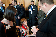 Montana Senator Jon Tester (D) talks with Ian Lovshin of Helena during the Montana Coffee on Capitol Hill.