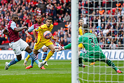 Philippe Coutinho of Liverpool scores a goal past Jores Okore and Shay Given of Aston Villa to make it 0-1 - Photo mandatory by-line: Rogan Thomson/JMP - 07966 386802 - 19/04/2015 - SPORT - FOOTBALL - London, England - Wembley Stadium - Aston Villa v Liverpool - FA Cup Semi Final.