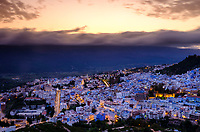 CHEFCHAOUEN, MOROCCO - CIRCA APRIL 2017: Sunset in Chefchaouen as seen from a hilltop. This is a popular tourist destination in Morocco