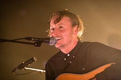 """© Licensed to London News Pictures. 10/12/2014. London, UK.   Ben Howard performing live at Brixton Academy.   Benjamin John """"Ben"""" Howard is an English singer- songwriter and is touring to promote his second studio album """"I Forget Where We Were"""" which he released in October 2014.  Photo credit : Richard Isaac/LNP"""