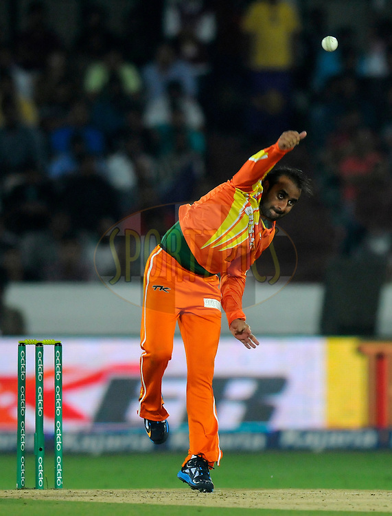 Adnan Rasool of Lahore Lions bowls during match 7 of the Oppo Champions League Twenty20 between the Kolkata Knight Riders and the Lahore Lions held at the Rajiv Gandhi Cricket Stadium, Hyderabad, India on the 21st September 2014<br /> <br /> Photo by:  Pal Pillai / Sportzpics/ CLT20<br /> <br /> <br /> Image use is subject to the terms and conditions as laid out by the BCCI/ CLT20.  The terms and conditions can be downloaded here:<br /> <br /> http://sportzpics.photoshelter.com/gallery/CLT20-Image-Terms-and-Conditions-2014/G0000IfNJn535VPU/C0000QhhKadWcjYs