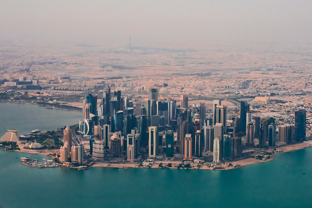 Aerial view of skyscrapers lining the Cornice, the waterfront promenade in Doha, Qatar in the Persian Gulf.
