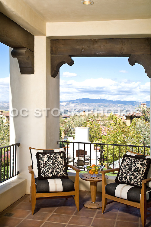 Stock Photo of Master Bedroom Balcony with Outdoor Furniture with View of Mountains