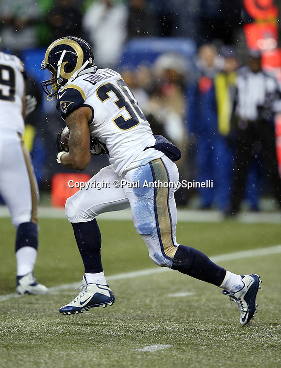 St. Louis Rams running back Todd Gurley II (30) runs the ball and burns the time clock late in the fourth quarter with the Rams leading the Seattle Seahawks during the 2015 NFL week 16 regular season football game against the Seattle Seahawks on Sunday, Dec. 27, 2015 in Seattle. The Rams won the game 23-17. (©Paul Anthony Spinelli)