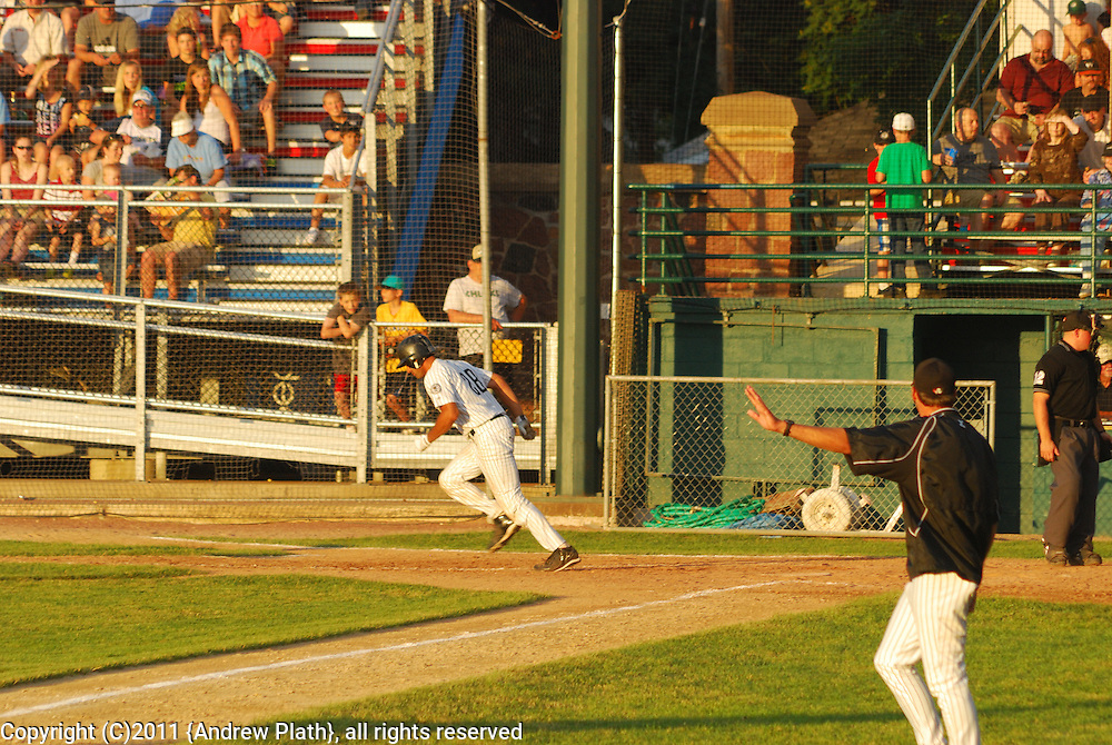#18 Garrett Yrigoyen  Woodchucks INF/RHP makes a run against the Eau Claire Express.
