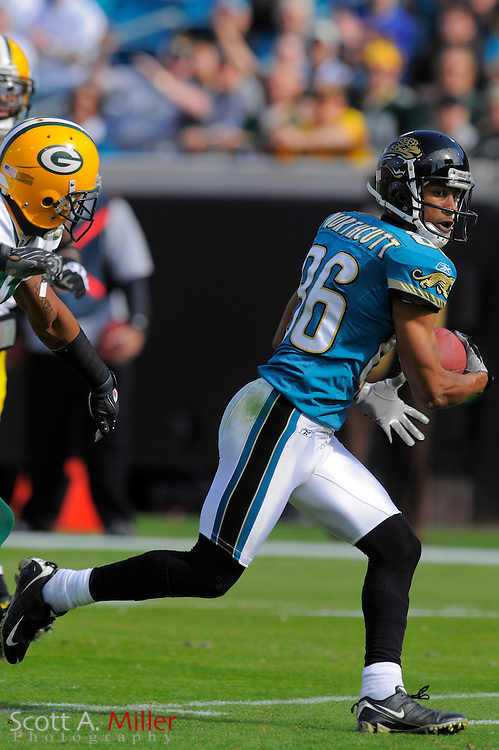 Dec. 14, 2008; Orlando, FL, USA; Jacksonville Jaguars wide receiver Dennis Northcutt (86) scores during the first half of the Jags game against the Green Bay Packers at Jacksonville Municipal Stadium. Mandatory Credit: Scott A. Miller-US PRESSWIRE...©2008 Scott A. Miller