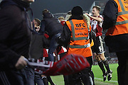 An impromptu pitch invasion is started after Harley Deans equalising goal during the Sky Bet Championship match between Brentford and Fulham at Griffin Park, London, England on 21 November 2014.