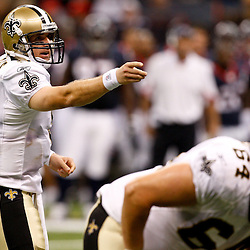 August 21, 2010; New Orleans, LA, USA; New Orleans Saints quarterback Drew Brees (9) calls a play at the line of scrimmage during the first quarter of a preseason game against the Houston Texans at the Louisiana Superdome. Mandatory Credit: Derick E. Hingle