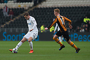 Swansea City Midfielder Gylfi Sigurdsson (23) on the attack with Hull City Midfielder Sam Clucas (11) chaseing during the Premier League match between Hull City and Swansea City at the KCOM Stadium, Kingston upon Hull, England on 11 March 2017. Photo by Craig Zadoroznyj.