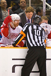 April 29, 2010; San Jose, CA, USA;  Detroit Red Wings head coach Mike Babcock talks with NHL referee Paul Devorski during the second period of game one of the western conference semifinals of the 2010 Stanley Cup Playoffs against the San Jose Sharks at HP Pavilion. San Jose defeated Detroit 4-3. Mandatory Credit: Jason O. Watson / US PRESSWIRE