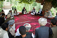Village elders attend a shura (council) in the village of Shamera with visiting MP Ms. Fawzia Koofi. The shura is a moment where they can talk about their problems and search for solutions. Their village hit by an avalanch last winter, they look to Ms. Koofi for help in building a security wall to prevent more destruction during the coming winter. Badakshan, Afghanistan, 2012