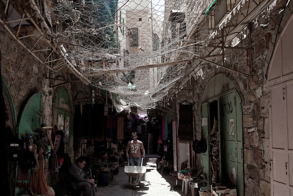 The palestinians put metal gratings to protect the waste thrown by settlers. In the old souq of Hebron, West Bank.