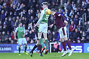 Aaron Hughes beats Olly Shaw to the ball during the William Hill Scottish Cup 4th round match between Heart of Midlothian and Hibernian at Tynecastle Stadium, Gorgie, Scotland on 21 January 2018. Photo by Kevin Murray.