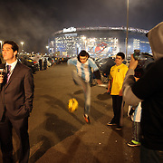 Argentina and Ecuador fans in the car park during a television interview before the Argentina Vs Ecuador International friendly football match at MetLife Stadium, New Jersey. USA. 15th November 2013. Photo Tim Clayton