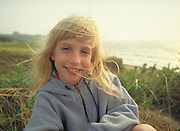 Young girl and sand dunes, Block Island, Rhode Island