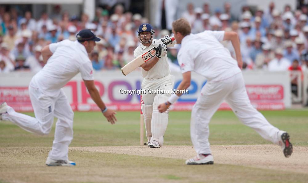 Sachin Tendulkar finds both Tim Bresnan and bowler Stuart Broad (right) obstruct his drive during the second npower Test Match between England and India at Trent Bridge, Nottingham.  Photo: Graham Morris (Tel: +44(0)20 8969 4192 Email: sales@cricketpix.com) 01/08/11