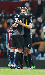 BIRMINGHAM, ENGLAND - Easter Sunday, March 31, 2013: Liverpool's captain Steven Gerrard and Luis Alberto Suarez Diaz celebrate the 2-1 victory over Aston Villa during the Premiership match at Villa Park. (Pic by David Rawcliffe/Propaganda)