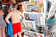 News stand. Newspapers on sale from all over the world keeping the tourists in touch with home.