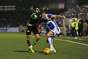 Bristol Rovers Lee Brown (3) battles for the ball against  Doncaster Rovers Niall Mason (8) during the EFL Sky Bet League 1 match between Bristol Rovers and Doncaster Rovers at the Memorial Stadium, Bristol, England on 23 December 2017. Photo by Gary Learmonth.