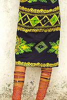 Kuna Indian woman selling in native costume with beaded leggings, Paseo de Las Bovedas, Casco Viejo (the Old City), San Felipe, Panama City, Panama
