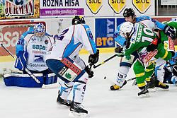 Brock McBride (HDD Tilia Olimpija, #10) vs Adam Munro (SAPA Fehervar AV19, #51) during ice-hockey match between HDD Tilia Olimpija and SAPA Fehervar AV19 at sixth match in Quarterfinal  of EBEL league, on March 1, 2012 at Hala Tivoli, Ljubljana, Slovenia. HDD Tilia Olimpija won 4:3 and advanced to semifinal. (Photo By Matic Klansek Velej / Sportida)