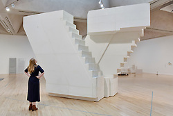 "© Licensed to London News Pictures. 11/09/2017. London, UK. A staff member views ""Untitled (Stairs)"", 2001, at the preview of an exhibition featuring works by artist Rachel Whiteread at Tate Britain.  The exhibition spans her career over three decades and runs 12 September to 21 January 2018.   Photo credit : Stephen Chung/LNP"
